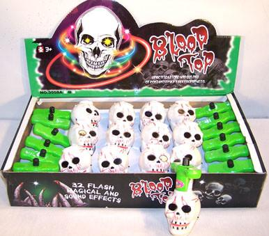 Skull Spinning Laughing LED Toy