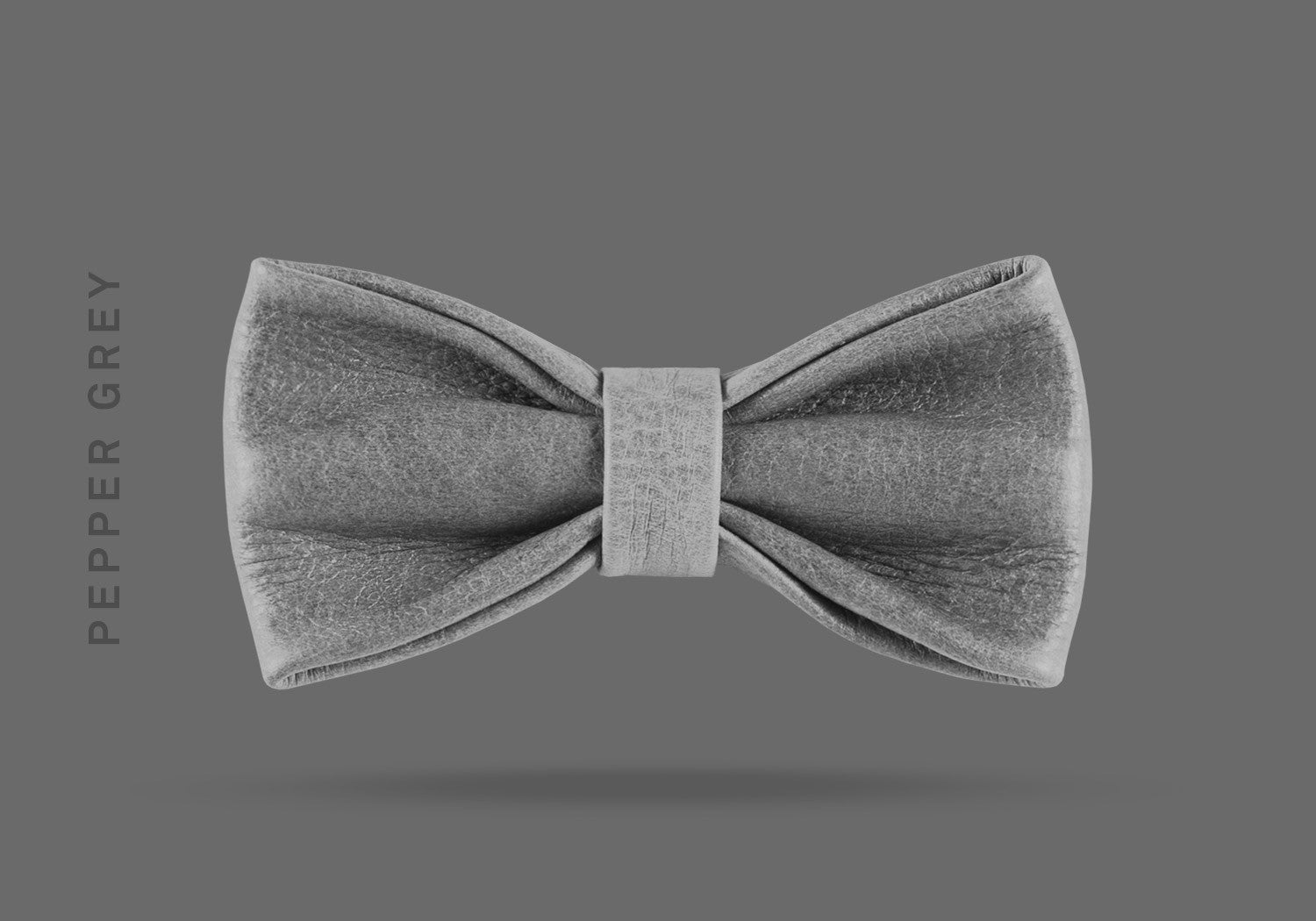 This pepper grey WEEF handmade leather bow is a great present or gift idea for dapper and stylish gentlemen for fathers day, valentines day or Christmas.