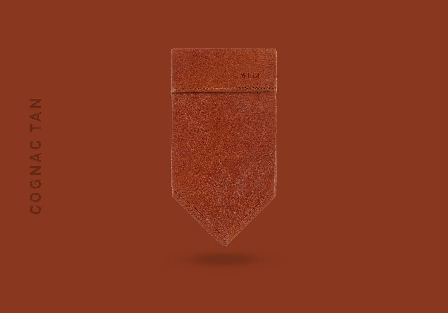 This cognac tan WEEF handmade leather pocket square is a great present or gift idea for dapper and stylish gentlemen for fathers day, valentines day or Christmas.