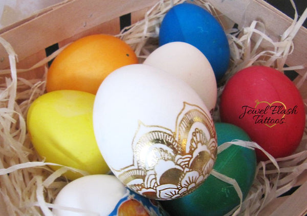 Cute Easter eggs decorated with gold metallic tattoos | Photo by Jewel Flash Tattoos