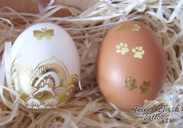 Easter eggs with Mandala, butterfly and cat paw prints metallic tattoos | photo