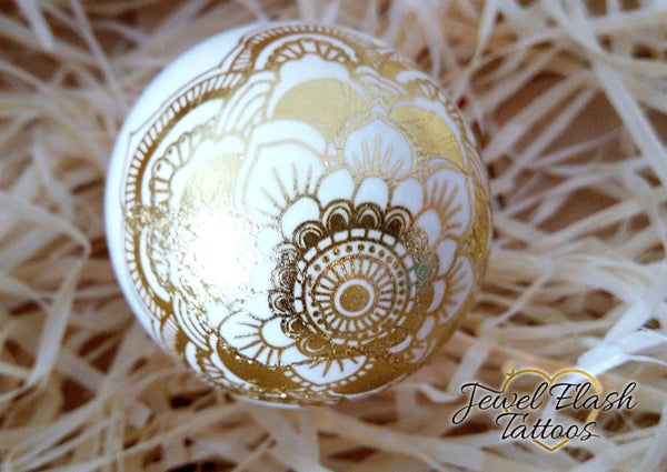 Easter egg with gold metallic Mandala tattoo design | photo by Jewel Flash Tattoos