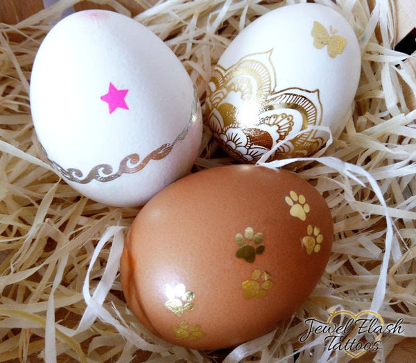 White and brown Easter eggs with gold metallic tattoos decor | Image