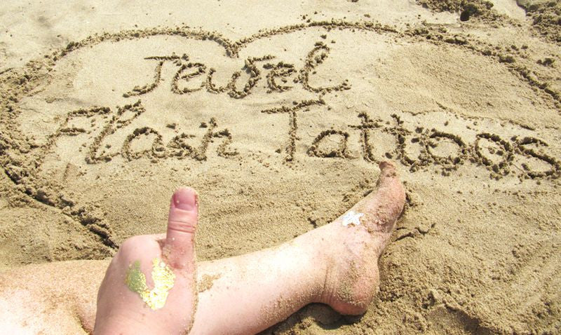 Jewel Flash Tattoos name written on the sand