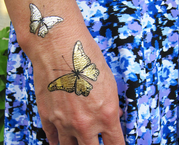 Spring butterfly tattoos for women | Jewel Flash Tattoos image