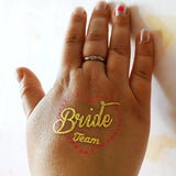 Bride Team tattoos for bachelorette party, gold tattoo, pink heart frame | Photo by Jewel Flash Tattoos