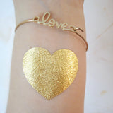 Heart temporary tattoo in metallic gold ink (foil) | Photo by Jewel Flash Tattoos