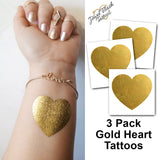 Gold heart shaped temporary tattoos for women | Photo by Jewel Flash Tattoos