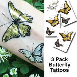 Butterfly tattoos in metallic gold and silver ink with black accents | Jewel Flash Tattoos photo