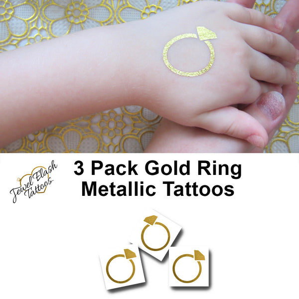 Gold wedding ring tattoo | Jewel Flash Tattoos photo