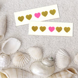 Small tattoos heart-shaped stickers made of gold foil