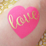 Pink heart temporary tattoos with gold love script