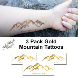 Mountain flash tattoos in metallic gold color with Dream Big script