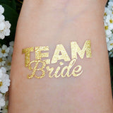 Temporary gold team bride tattoos for wedding and bachelorette party | Photo by Jewel Flash Tattoos