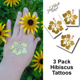 Hibiscus temporary tattoos, Hawaii flower tattoo stickers in gold | Photo by Jewel Flash Tattoos
