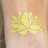 Lotus flower temporary gold tattoo for yoga women | Photo by Jewel Flash Tattoos
