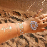 Mermaid scales, anchor, pearl temporary tattoos for summer beach parties | Photo by Jewel Flash Tattoos