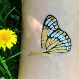 Temporary monarch butterfly tattoo for women, summer tattoos | Photo by Jewel Flash Tattoos