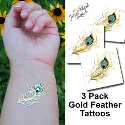 Peacock feather temporary metallic gold tattoos for women | Photo by Jewel Flash Tattoos