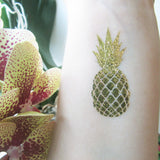 Gold pineapple temporary flash tattoos: jewelry-inspired body stickers