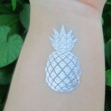 Silver pineapple tattoos