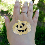 Pumpkin temporary tattoos for Halloween, body stickers | Photo by Jewel Flash Tattoos