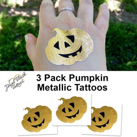 Jack o-lantern temporary tattoo for Halloween, gold tattoos | Photo by Jewel Flash Tattoos