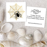 Black spider tattoo on metallic gold web and instructions | Image by Jewel Flash Tattoos