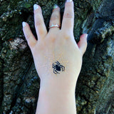 Halloween temporary tattoo black spider on metallic gold net | Photo by Jewel Flash Tattoos