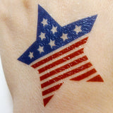 Patriotic tattoos for July 4th, star USA flag design | Photo by Jewel Flash Tattoos