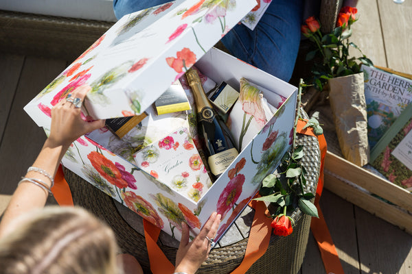 Luxury Hamper with illustrated box and products including Camel Valley wine, floral notebook, Chocolarder chocolate and floral tea towel