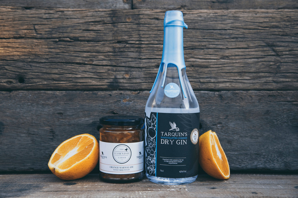 Cornish Larder product with Tarquin's gin bottle, styled against a wooden wall