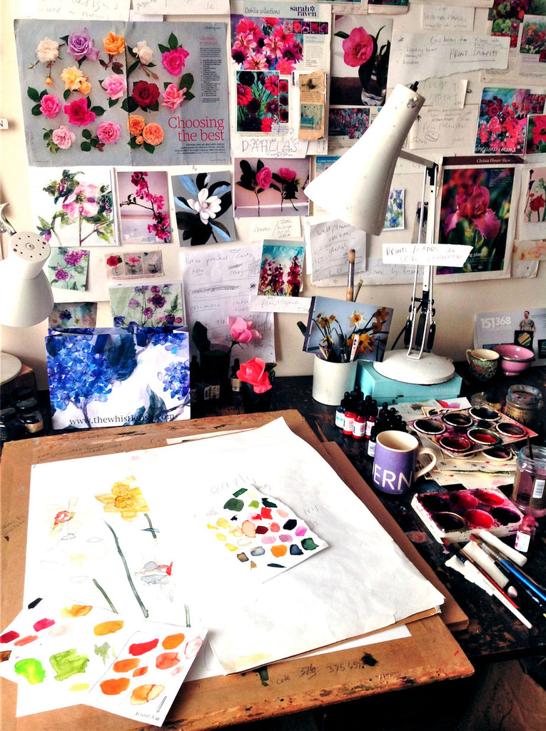 Jess Trotman's studio full of plant photographs and wooden drawing board