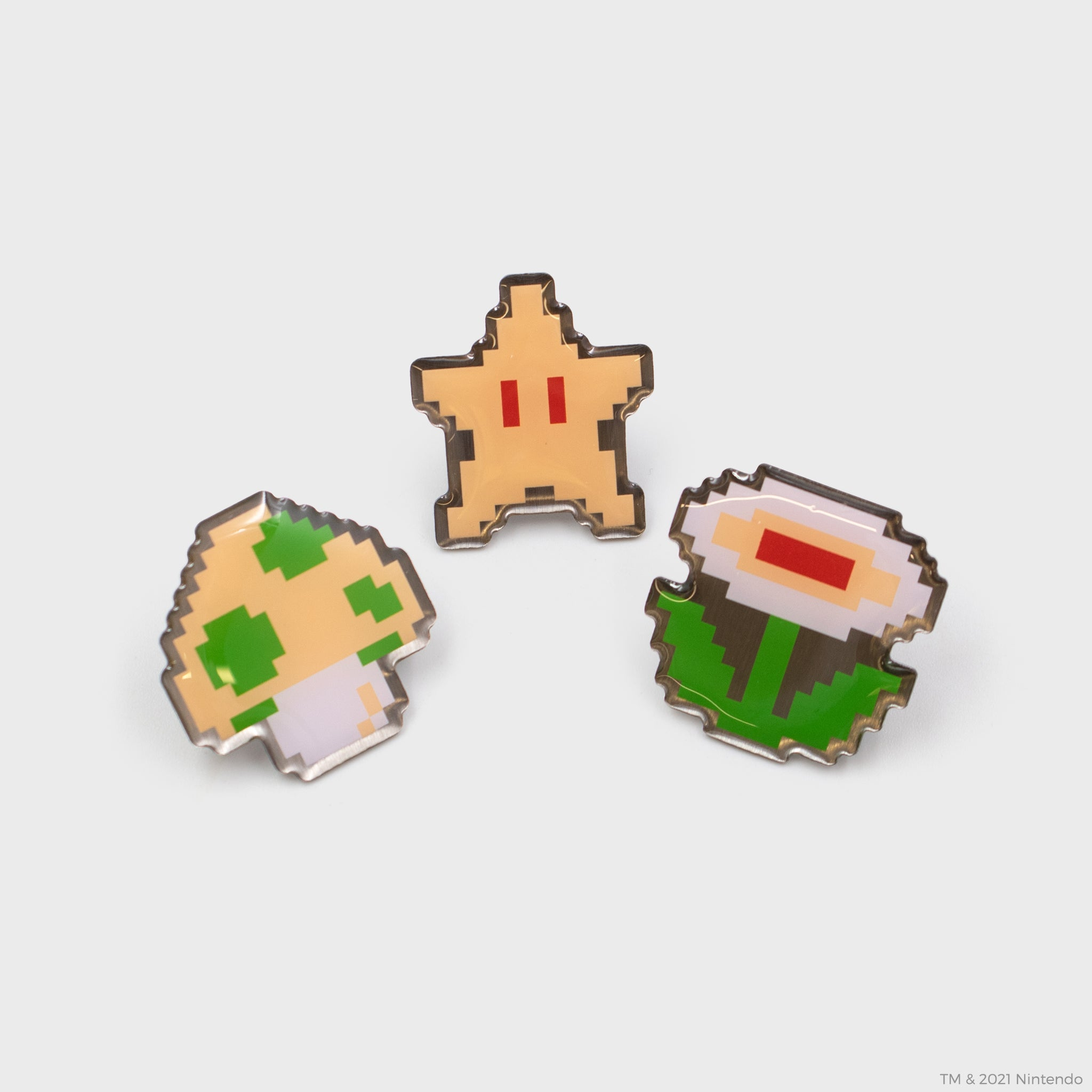 nintendo super mario bros. nes nintendo entertainment system collector's box 8-bit classic retro video games gaming pins pin set power-ups 1-up mushroom fire flower star culturefly