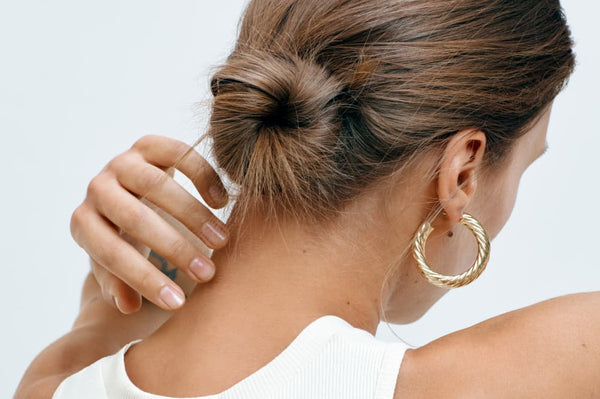 image of woman facing to the side showing a hoop earring