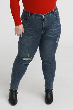 Ripped skinny jeans in dark stonewash blue