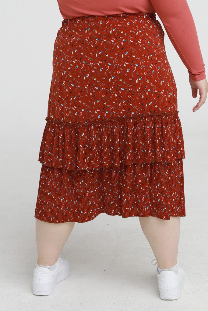 Double layer floral skirt in orange with pleated details
