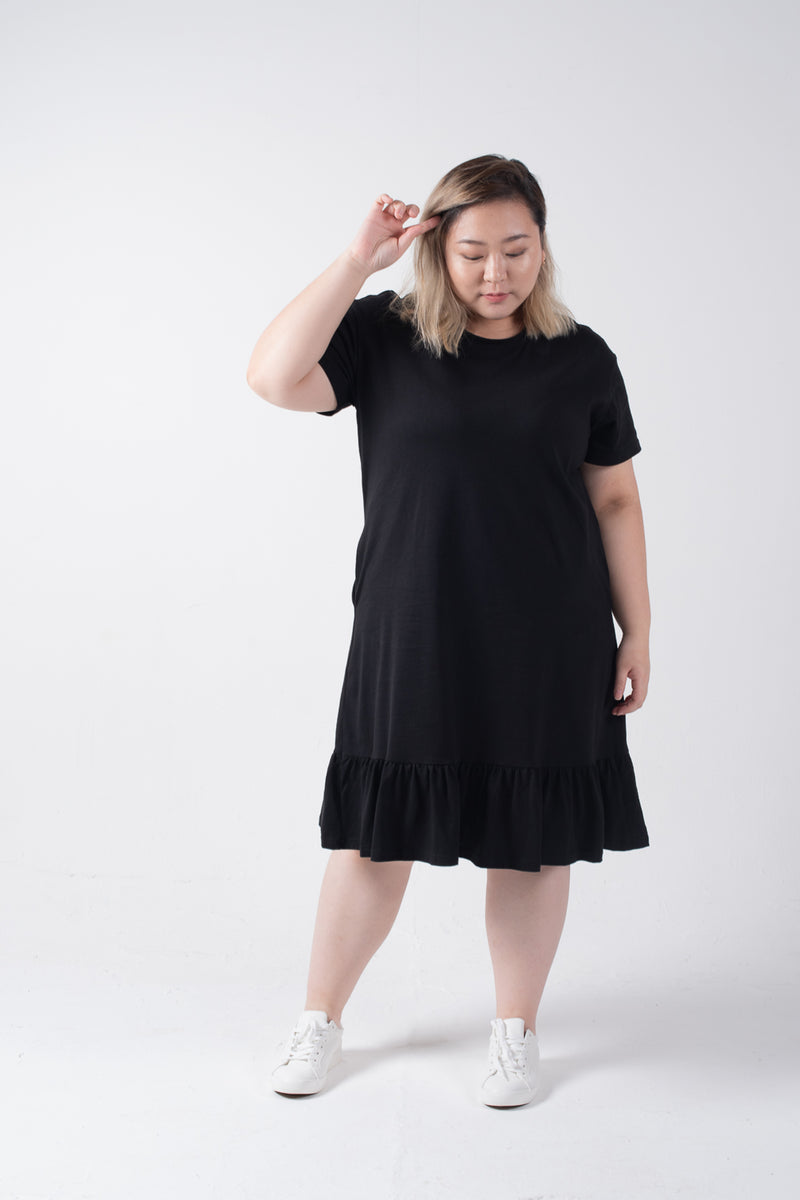 Dress In Black With Ruffle Hem Details
