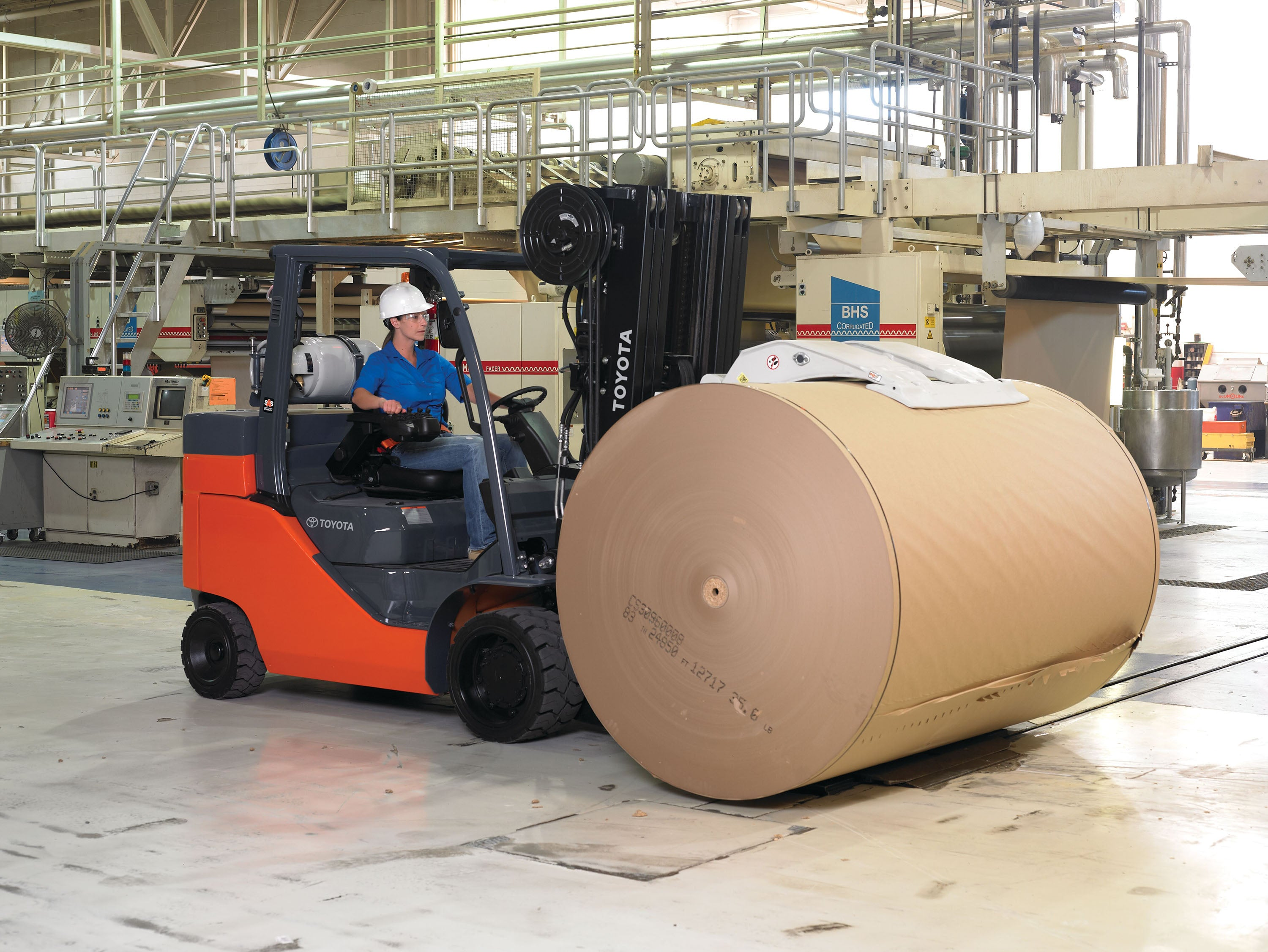 Increase Productivity Using Forklifts and Attachments