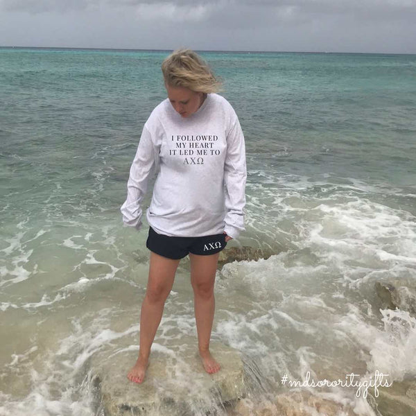 Model wearing Sorority Shorts at the Beach with sorority long sleeve shirt