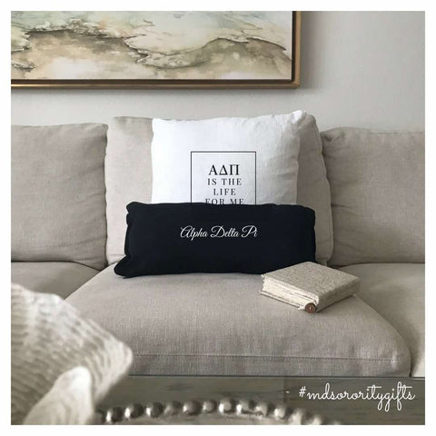 Alpha Delta Pi Decorative Pillow on sofa with black Alpha Delta Pi lumbar pillow