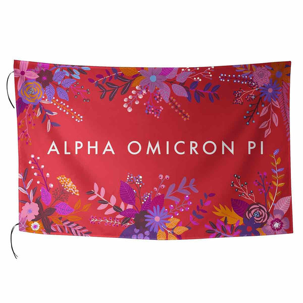 Alpha Omicron Pi Flag in pretty pink with tropical palm leaves and sorority name in cursive.