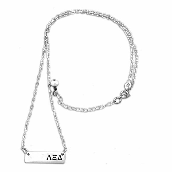 Alpha Xi Delta Bar necklace with adjustable chain.