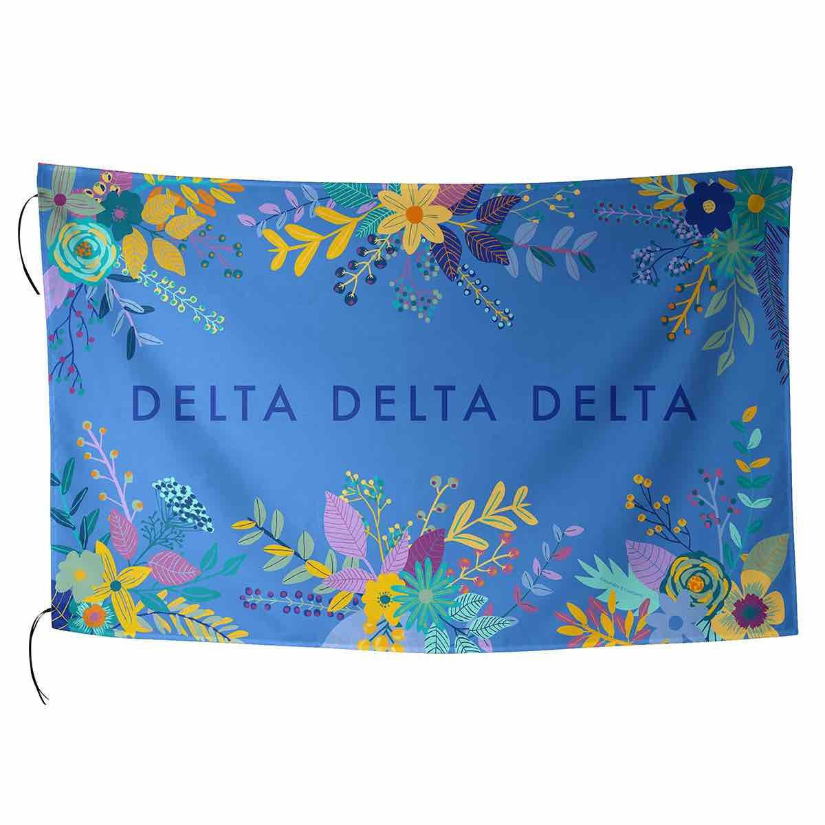 Delta Delta Delta Flag in pretty pink with tropical palm leaves and sorority name in cursive.