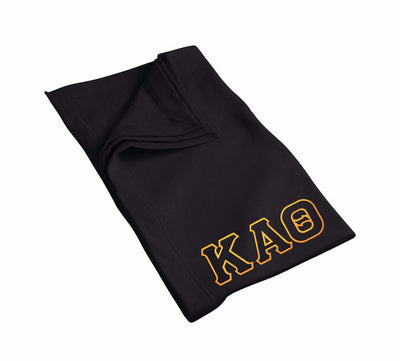 Kappa Alpha Theta blanket with black & gold Greek Letters..