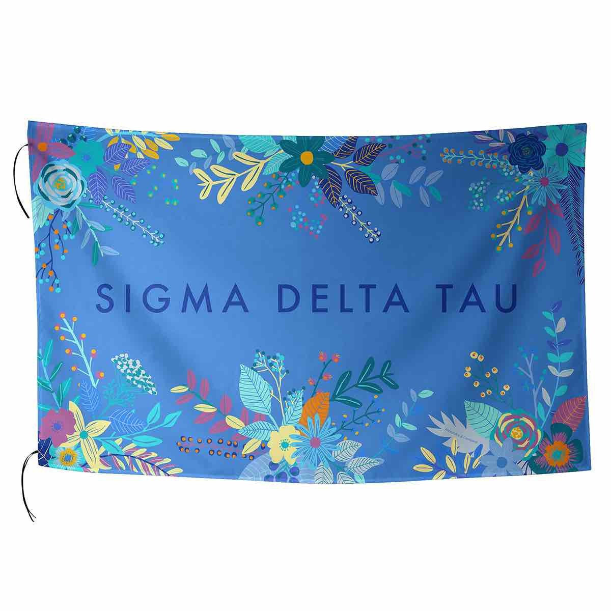 Sigma Delta Tau Flag in pretty pink with tropical palm leaves and sorority name in cursive.