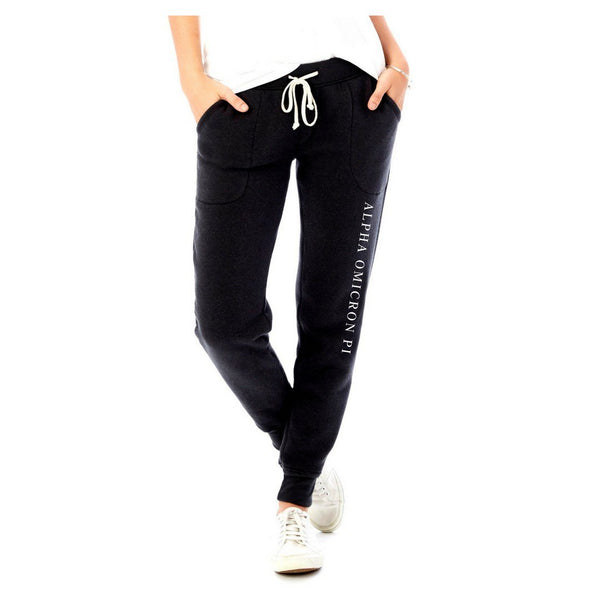 Alpha Omicron Pi joggers. Warm fleece sweatpants in black with white sorority name down leg. Slim fit. #AlphaOmicronPi clothing you will love to wear! Shop #AOPII Clothing Collection for other coordinating items available only at M&D Sorority Gifts!