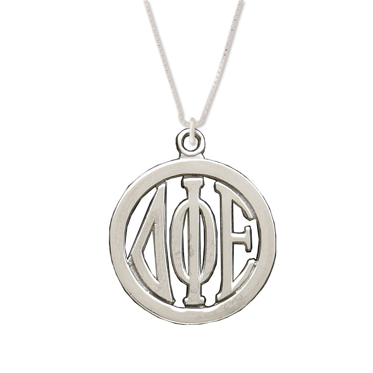 Delta Phi Epsilon charm in medallion shape.