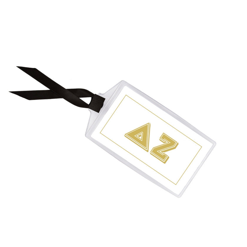 Delta Zeta luggage tag measures 3.5 inches x 2 inches with black grosgrain ribbon.