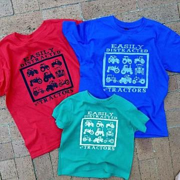 The Whole Herd Kid's Green T-Shirt Easily Distracted by Tractors
